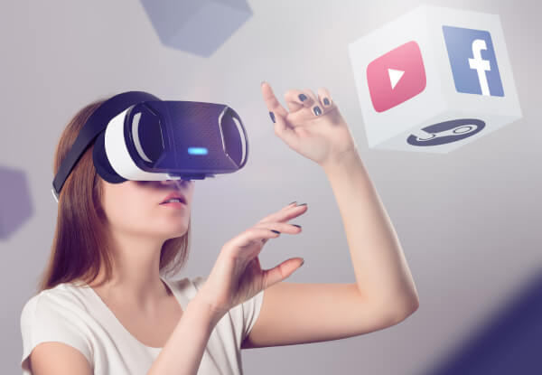Woman in VR headset looking up and interacting with Facebook You